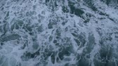 ランニング : Waves beside the ship that is sailing in the sea, Top view of the sea while a boat running, Slow motion. 動画素材