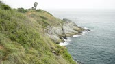 çarpıcı : Scenery of Phrom Thep Cape in andaman sea which is a famous stunning view point in phuket, Thailand. Stok Video