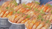 Baked prawns are ready serve and selling at seafood festival in phuket, Thailand. Stock Footage