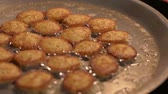 Fried fishs eggs in a pan with bubbling oil while cooking. Thailand iconic street food. Stock Footage