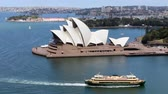 Ship sailing in Sydney Harbour near Opera House Стоковые видеозаписи