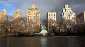 The Conservatory Water in Central Park, and buildings along Fifth Avenue, New York, New York