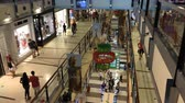 High speed shot of people Christmas shopping at three levels in Buenos Aires shopping mall.
