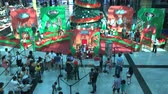 Wide shot of kids with Santa Claus taking photos in a mall of Buenos Aires, Argentina