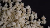 Close up shot of popcorn falling in slow motion
