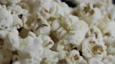 Macro detail close up of popcorn falling into shot