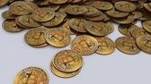 Frontal shot of a large amount of Bitcoins on a table