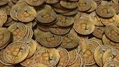 Side shot of a large amount of Bitcoins on a table