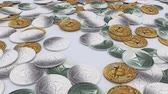 Close up front shot of a large amount of Bitcoins and Ethereums cryptocurrency on a table
