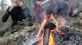 consciência : shamanic woman playing on shaman frame drum in the nature around the fire and a man playing a harp