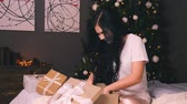 jewelry box : Portrait of young beautiful woman with decorated tree. New years eve Stock Footage