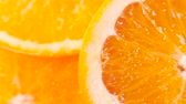 mirtilo : sliced ripe orange with drops of juice. Closeup macro shot. Fresh berry series. 4k Stock Footage