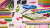 borracha : Shot of a school desk with different colorful supplies. Sliding focus. 4k.