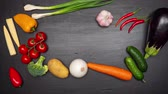 patlıcan : Fresh vegetables frame on the kitchen table. View from top. Space fo text. Stop motion. Stok Video