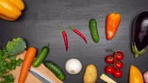 patlıcan : Fresh vegetables half frame on the kitchen table. View from top. Space fo text. Stop motion.