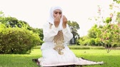 islam : Muslim woman worship of the Allah.