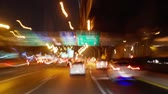 Driving at night in Bangkok downtown (drive time lapse). Night driving with car with cars in motion. Stock mozgókép