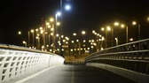 asphalt : Empty bridge at night with lights and cars