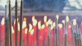 постоянный : Smoke from incense sticks at chinese shrine