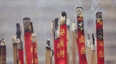 постоянный : Smoke from incense sticks at chinese shrine slow motion