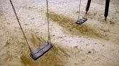 ベンチ : Empty swings on the playground