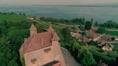 renesans : Magnificent 4k aerial drone panorama view on ancient medieval castle on green hill in province wine yard field landscape Wideo