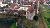 Impressive 4k aerial drone landscape view on big medieval ancient city with old architecture building church by river