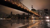 Magnificent low angle time lapse panorama view on night light illumination on modern Manhattan Brooklyn Bridge cityscape Stock mozgókép
