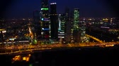 Incredible aerial drone view on bright evening night Moscow city illumination in busy metropolis downtown cityscape