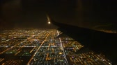 Impressive aerial flight view from passenger air plane wing on bright night big city light illumination dark black sky