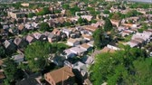 небольшой : Stunning drone panorama aerial tilt shift view on tiny houses villas in suburb town village neighborhood