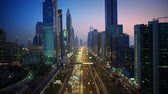 rosa : Magnificent downtown Dubai modern architecture highway in pink evening sunset night illumination on 4k aerial ciytscape