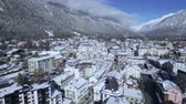 vadi : Beautiful luxury resort hotel villa cozy cottage village in snow covered winter forest in Alps mountain landscape