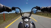 cromato : First person pov shot of professional biker riding fast downhill highway road on black motor bike in wonderful landscape
