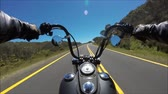 cromato : First person pov shot of professional biker riding fast downhill highway road on black motor bike in amazing landscape Filmati Stock