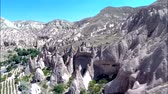 hava : Incredible aerial panorama view on huge sand stone rock canyon desert in mountain chain hill landscape Stok Video