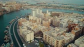 tradiční kultura : Fascinating 4k aerial drone panorama flyover in Dubai Emirate modern architecture of big harbor city near ocean water