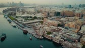 tradiční kultura : Magnificent 4k aerial drone panorama flyover in Dubai Emirate downtown modern architecture of big ocean harbor city