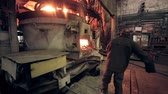 zinco : Worker on steel plant operates with  molten metal.
