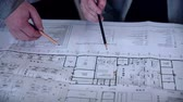 no people : Group engineers and architects discuss the blueprint. Stock Footage