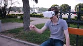 head mounted display : Young man in 360 VR glasses. Virtual reality glasses.