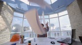 отставка : Annoyed, frustrated, angry businessman throwing a pile of documents in a clean bright office. Стоковые видеозаписи