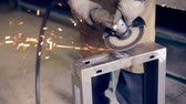 strength : Worker using industrial grinder operating with metal at a metal processing plant.
