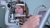fundus : Modern medical procedure. Ophthalmologist points at touchscreen during eye examining. Stock Footage