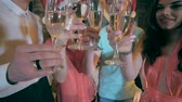 friends : Christmas Celebration. Friends holding glasses of champagne making a toast. Cheers. Close up.