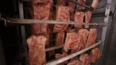 dry cured : Smoked meat, smoked ribs in factory warehouse. Meat processing factory.