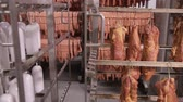 nakládané : Food storage, warehouse. Meat products, sausages hanging on racks in a meat warehouse, freezer. Dostupné videozáznamy