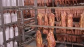 dry sausage : Smoked meat, smoked ribs in factory warehouse. Meat processing factory.