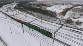 sleepers : Freight train on the railway in winter. Gasoline, fuel tanks. Aerial shot.