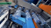 организованный : Manufacturing process at bottled water plant.